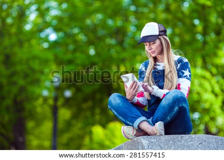 Young beautiful woman with tablet - stock photo
