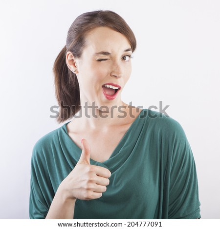 young beautiful woman  with thumbs up