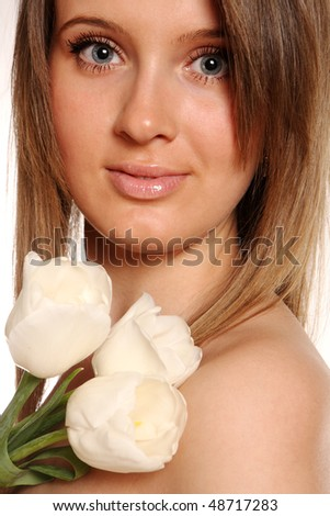 young beautiful woman with tulip flower - stock photo