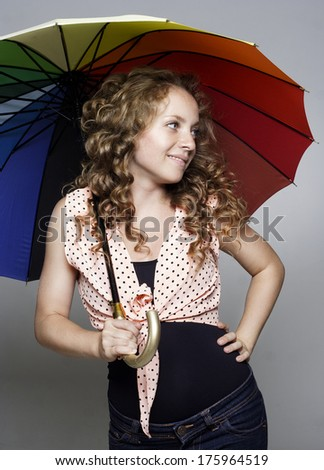 Young beautiful woman with umbrella - stock photo