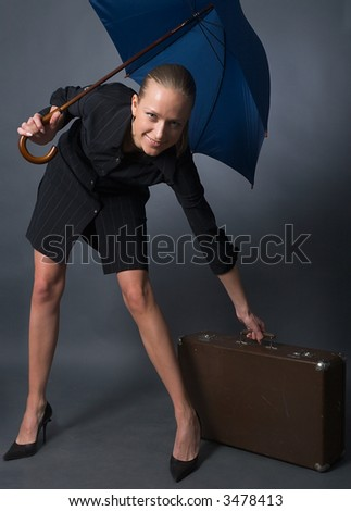 young beautiful woman with umbrella and suitcase