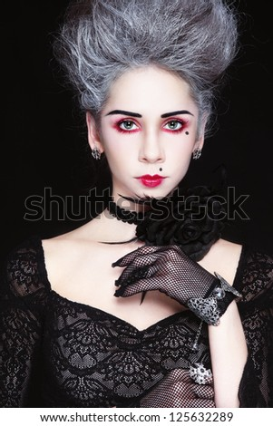 Young beautiful woman with vintage make-up and hairdo