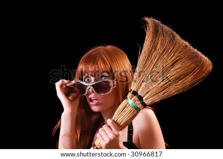 Young beautiful woman with whisk and glasses on black background - stock photo