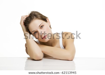 young beautiful woman with white backround looking relaxed - stock photo