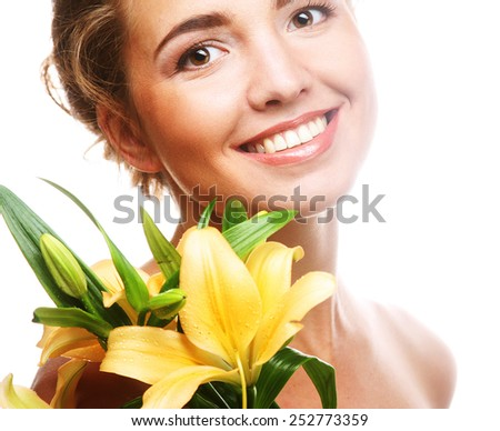 young beautiful woman with yellow flower, isolated on white - stock photo