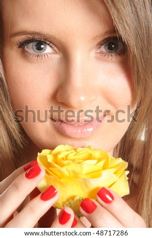 young beautiful woman with Yellow rose flower - stock photo