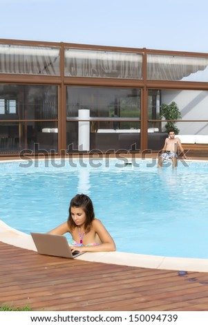 Young Couple Near Pool Woman Laptop Stock Photo 153253577 Shutterstock
