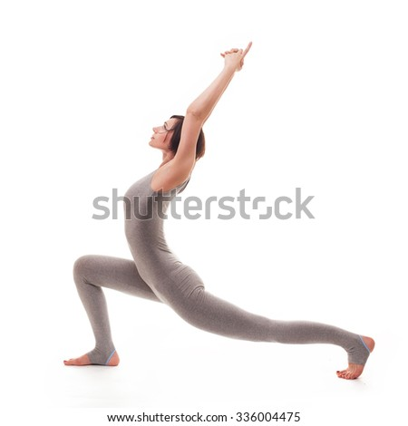young beautiful woman yoga posing on isalated white studio background - stock photo