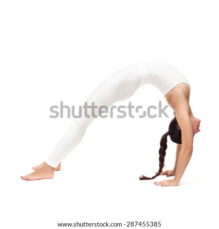 young beautiful woman yoga posing on isolated white studio background