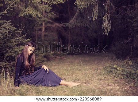 young beautiful women in autumn forest - stock photo