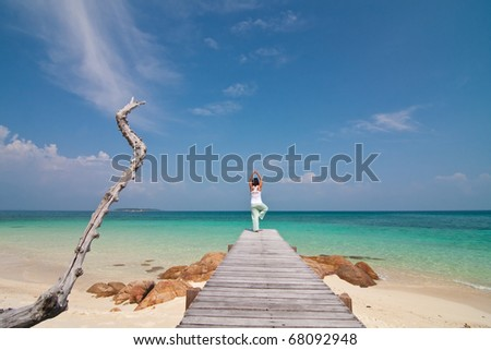 Young beautiful women relaxation on the sunny beach , Munnork Island, Rayong Province, Gulf of Thailand - stock photo