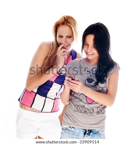 young beautiful women using the cellphone to send and receive sms - stock photo