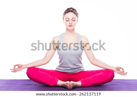 young beautiful yoga posing on a white studio background - stock photo