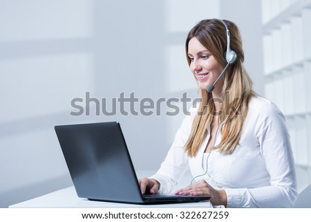 Young beauty businesswoman working in call center