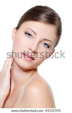 Young beauty clean female face over white background