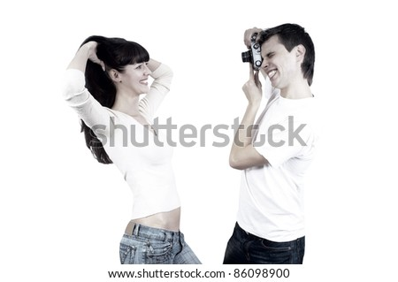 Young beauty couple with photo camera isolated on white background - stock photo