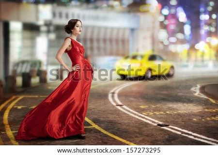 Young Beauty Famous Woman In Fluttering Red Dress Outdoor - stock photo
