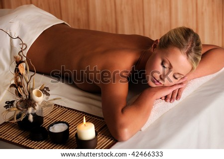 Young beauty female relaxing in spa salon - high angle view - stock photo