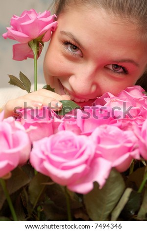 young beauty girl among pink roses