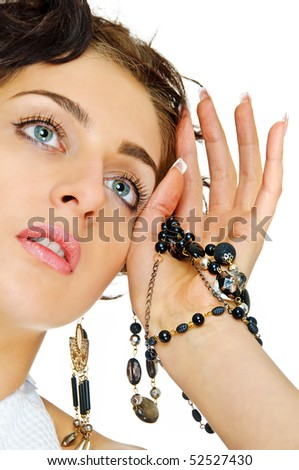 young beauty girl in pose with beads on white