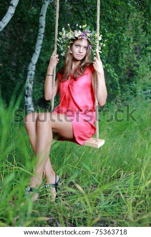 young beauty girl on swing outdoors