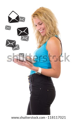 Young beauty girl with tablet - checking emails - stock photo