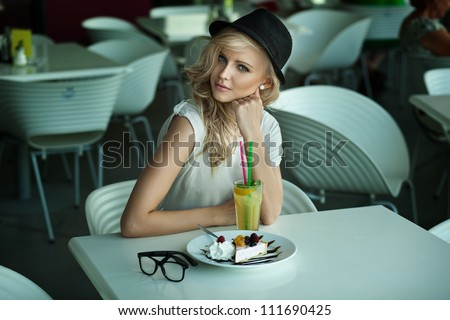 Young beauty in a restaurant - stock photo