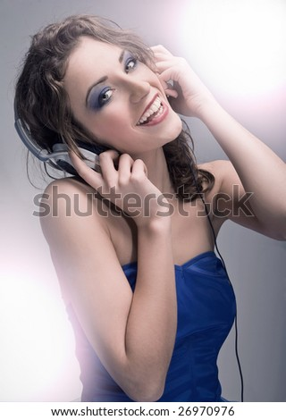 Young beauty listening to the music - stock photo