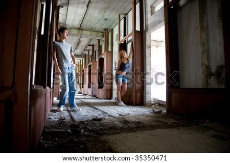 young beauty lovers in the rusty building