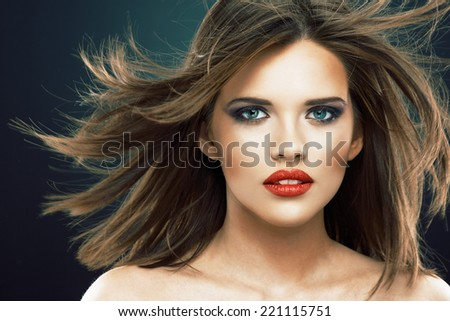 Young beauty model with blowing hair. Studio isolated portrait. - stock photo