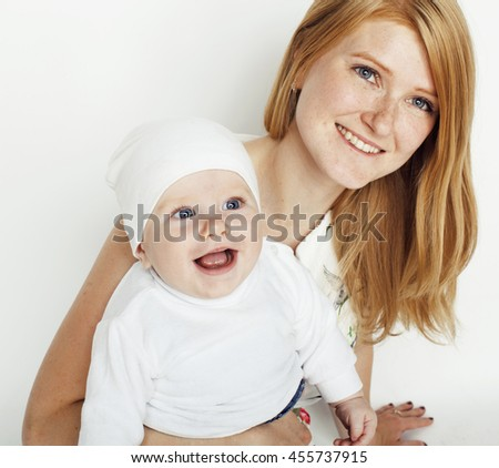 young beauty mother with baby, red head happy family isolated - stock photo