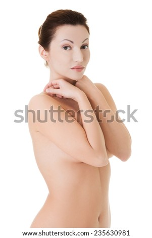 Young beauty naked woman covering her breast.