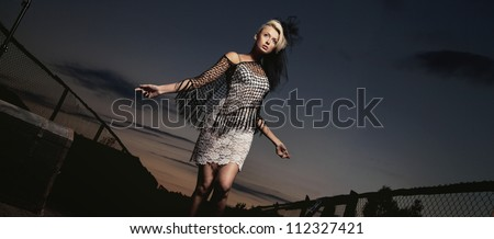 Young beauty on a evening walk - stock photo