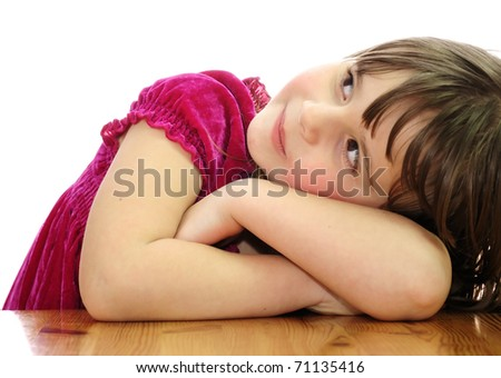 Young beauty on a table - stock photo