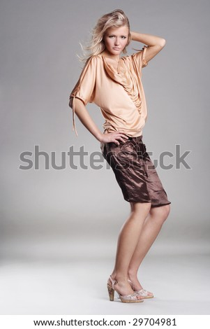 Young beauty on gray studio background - stock photo