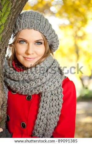 young beauty outdoor portrait with autumn park in background - stock photo