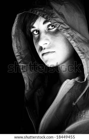 Young beauty protected with a cap from the dark. - stock photo