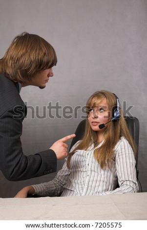 young beauty receptionist and her angry chief - stock photo
