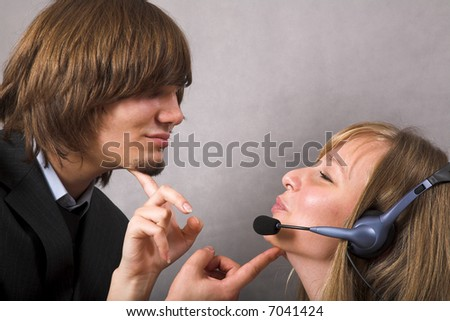 young beauty receptionist and her chief - stock photo
