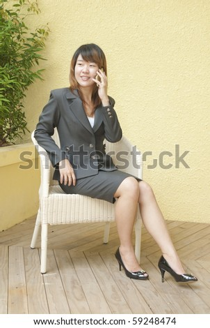 Young beauty smiling woman sitting in a cafe and talking on the cellphone