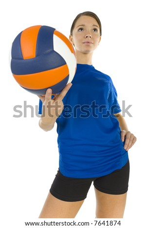 Young, beauty volleyball player. Holding ball, smiling and looking at something. White background, high angle view