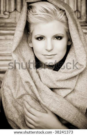 Young beauty wearing arab veil, sepia toned. - stock photo