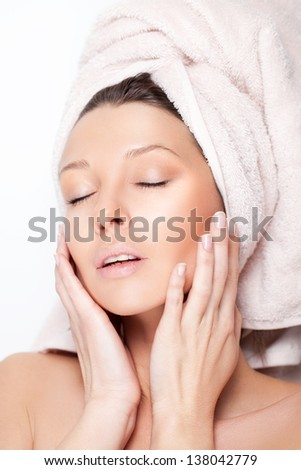 Young beauty wearing spa towel - stock photo