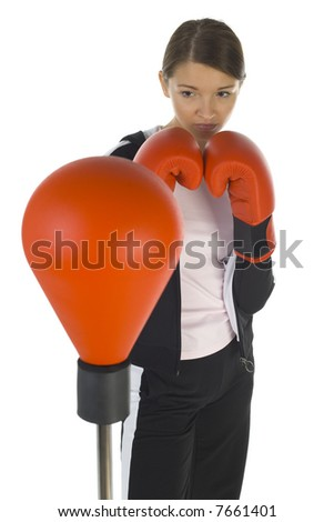 Young beauty with boxing gloves. Holding hilt-guard in front of punch bag. White background, front view