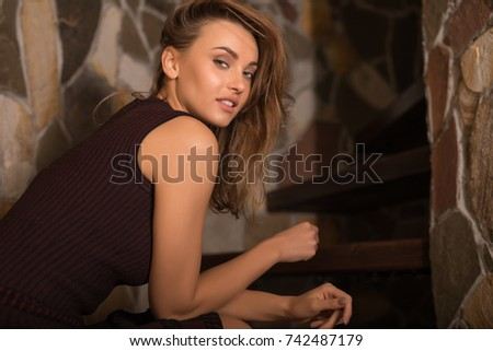 Young beauty woman against house interior.