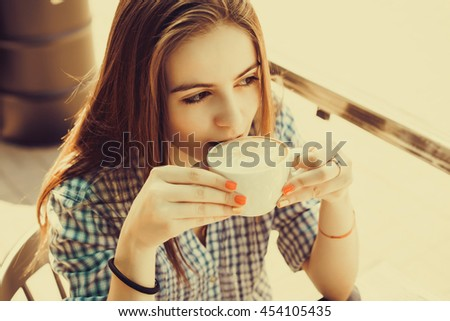 young beauty woman drink coffee in cafe, branch, breakfast, launch, cappuccino, outdoor portrait, fashion model, hipster style