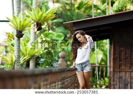 Young beauty woman enjoying her comfortable terrace. dancing - stock photo