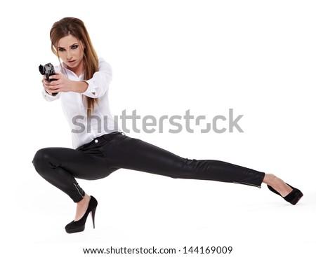young beauty woman holding handgun - stock photo