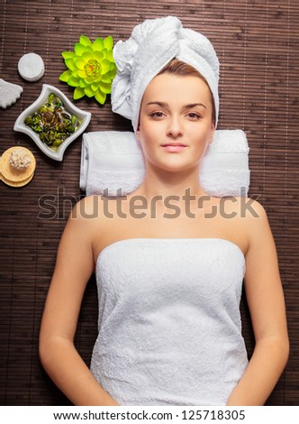 Young beauty woman in a spa - stock photo