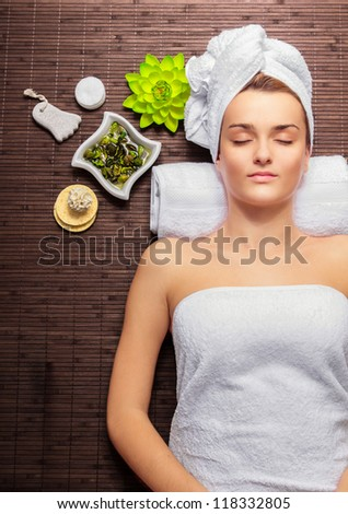 Young beauty woman in a spa with closed eyes - stock photo
